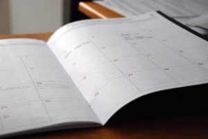 A paper diary containing events